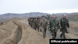 Armenian President Serzh Sarkisian (front left) visits a Karabakh Armenian army unit on January 3.