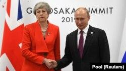 Тереза Мэй и Владимир Путин в Осаке, 28 июня 2019 года