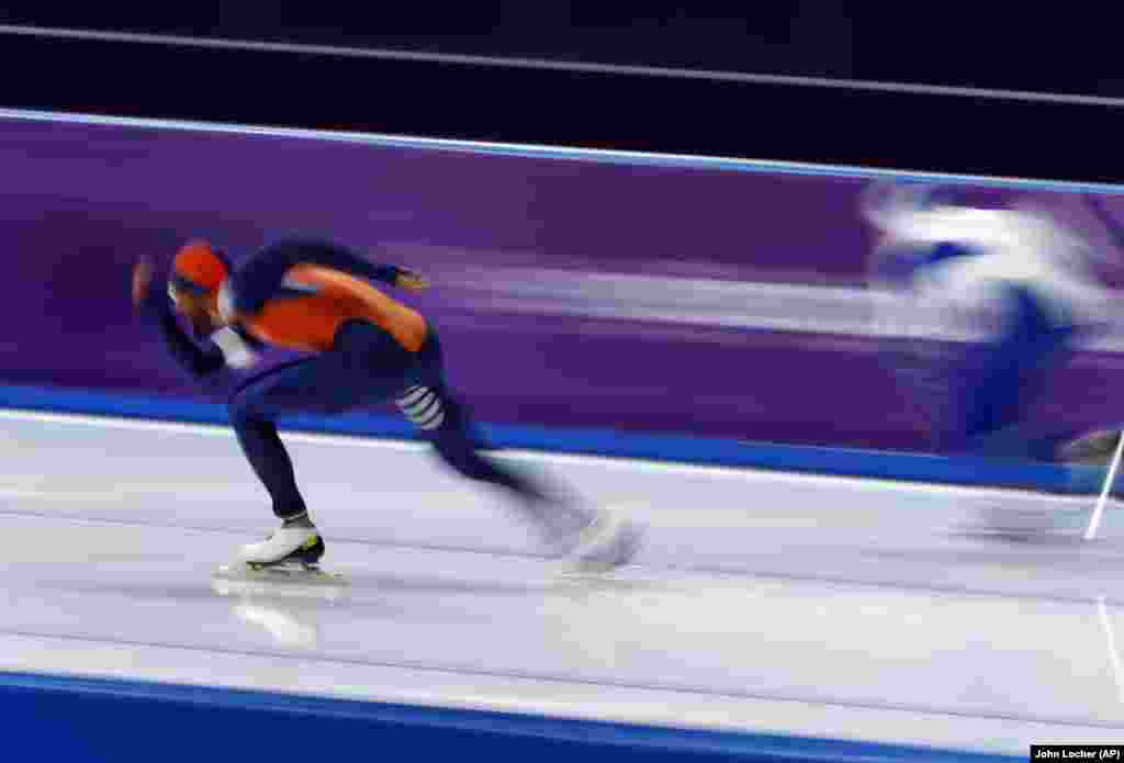 Speed Skating: Gold medalist Kjeld Nuis of The Netherlands, left, competes against Mika Poutala of Finland during the men's 1,000 meters speedskating race at the Gangneung Oval at the 2018 Winter Olympics in Gangneung, South Korea, February 23, 2018.