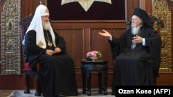 Russian Orthodox Church Patriarch Kirill (left) and Orthodox Ecumenical Patriarch Bartholomew I meet at St. George Church in Istanbul on August 31.