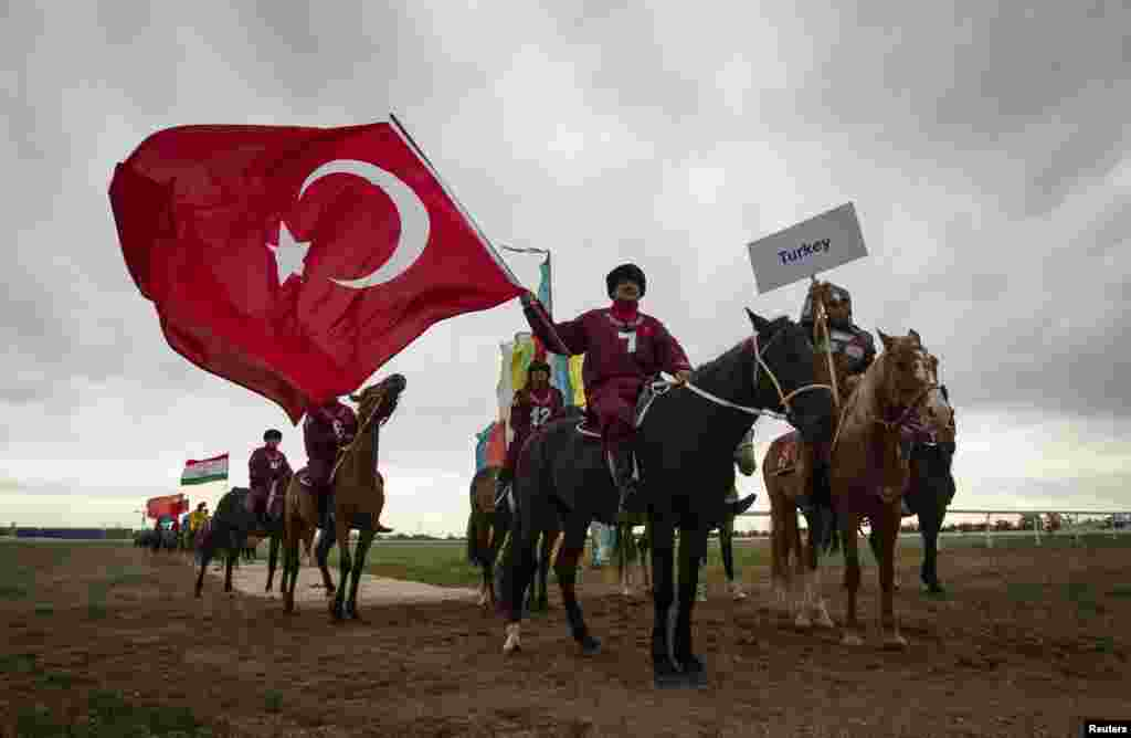 Riders from the Turkish team parade before the crowd at the opening ceremony of the kokpar championships in Astana.
