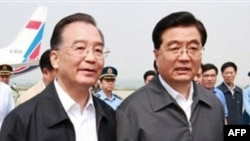 Chinese Premier Wen (left) and President Hu are leading the talks.