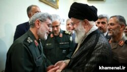 Iran's Supreme Leader Ali Khamenei receiving Esmail Qa'ani (Ghaani) during a meeting with military commanders. Undated. FILE photo