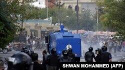 صفآرایی نیروهای امنیتی در مقابل معترضان در سلیمانیه عراق