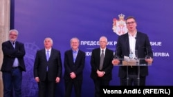Serbian President Aleksandar Vucic (right) couldn't help cracking a joke at a meeting with health specialists and epidemiologists on February 26 in Belgrade.