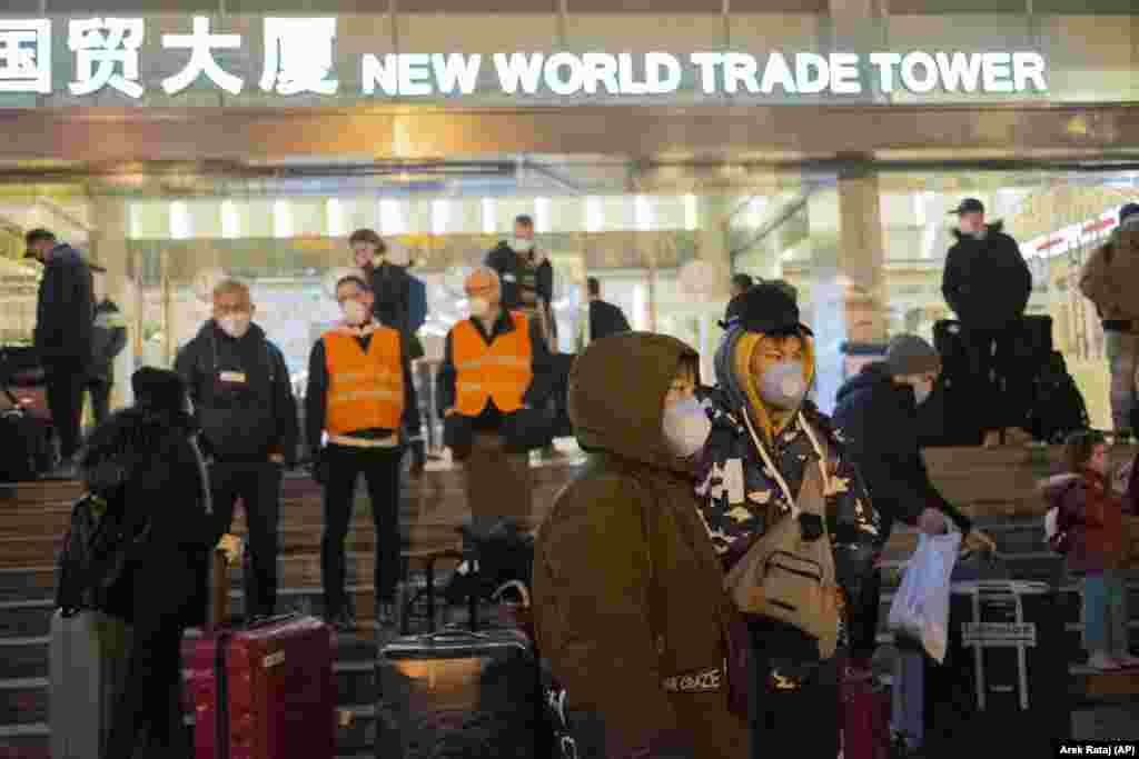 CHINA -- Evacuees gather on the steps of the New World Trade Tower Hotel before an evacuation flight for EU nationals in Wuhan in central China's Hubei Province, February 1, 2020