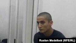Тойшыбек Асамов, подозреваемый в причастности к гибели студента Казахского национального аграрного университета (КазНАУ) Дидара Болысбекова, в суде. Алматы, 19 июня 2017 года.