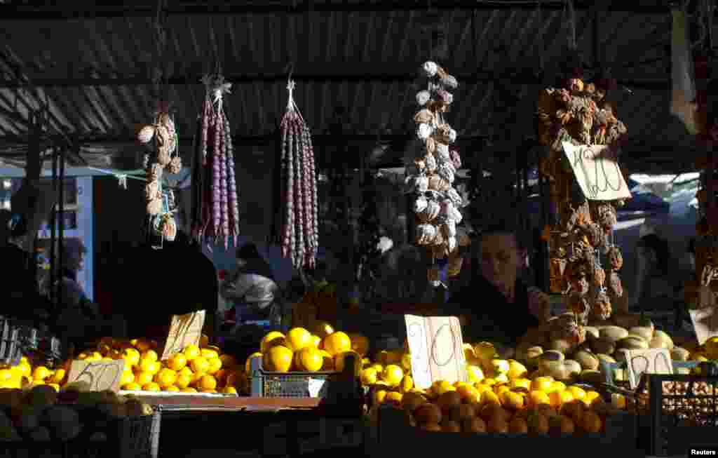 A vendor waits for customers at her stall at a market in Sukhumi.