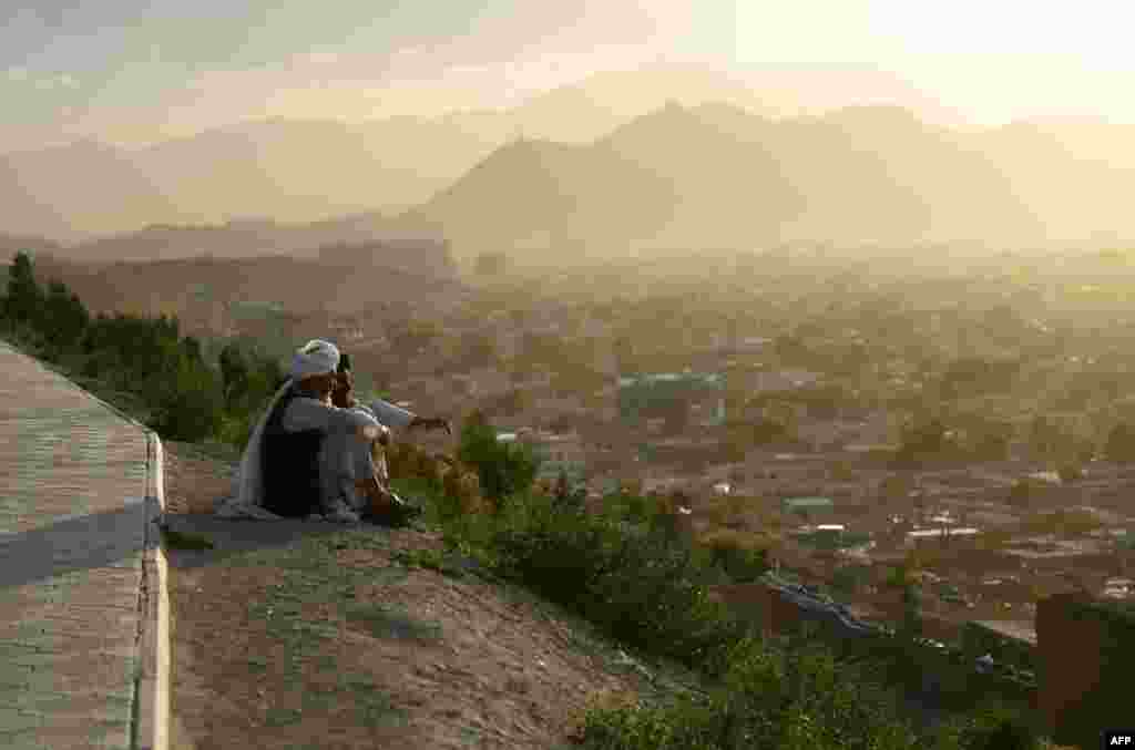 Kabul residents look out from the Wazir Akbar Khan hilltop overlooking the Afghan capital. (AFP/Farshad)