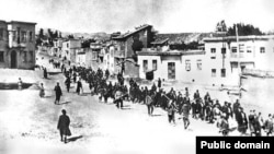 Armenians are marched to a nearby prison in Mezireh by armed Turkish soldiers in April 1915.