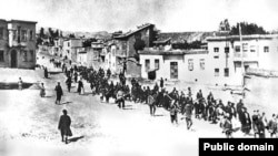 Armenians are marched to a nearby prison in Mezireh by armed Turkish soldiers in Kharpert in the Ottoman Empire in April 1915.