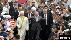 Kazakh President Nursultan Nazarbaev gestures to the crowd during the opening ceremony of the Hazrat Sultan mosque in Astana in July 2012.
