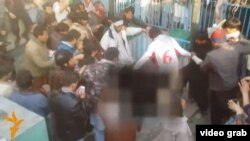 A screen capture from RFE video of a mob beating a woman to death after claiming that she burned a copy of the Koran on March 19.