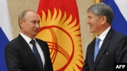 Russian President Vladimir Putin (left) meets with his Kyrgyz counterpart, Almazbek Atambaev, in Bishkek.