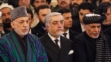 FILE: Afghan President Mohammad Ashraf Ghani (R), Afghan chief executive Abdullah Abdullah (C) and Afghan former president Hamid Karzai (L) during a ceremony in February 2019.