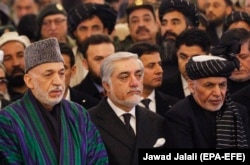 Afghan President Ashraf Ghani (right), Chief Executive Abdullah Abdullah (center), and former Afghan President Hamid Karzai attended the funeral ceremony.