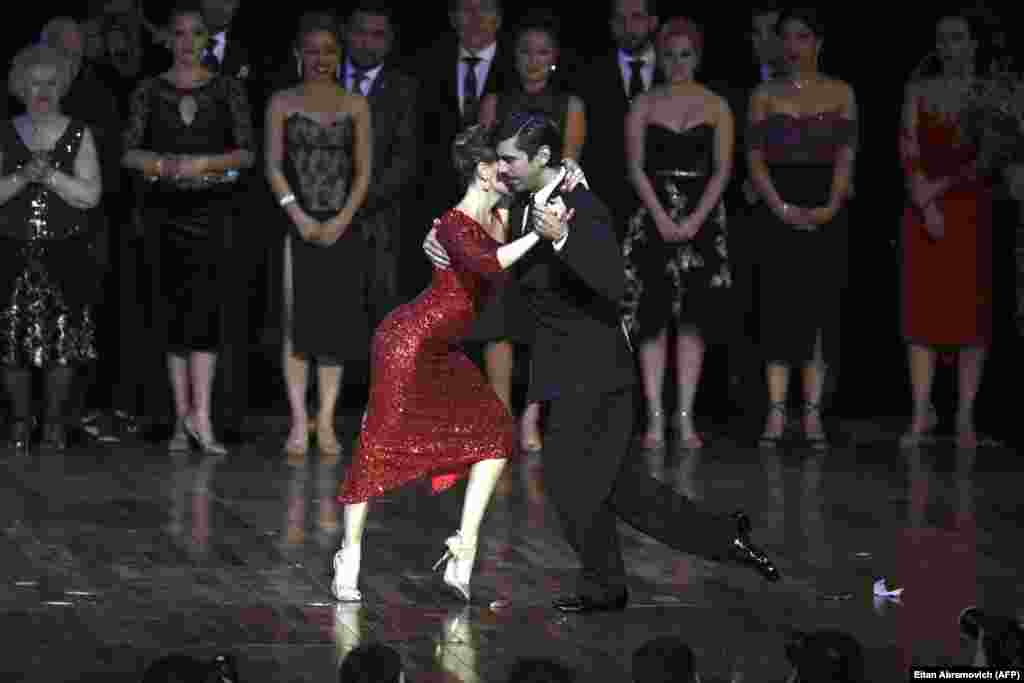 Argentina's German Ballejo (right) and Magdalena Gutierrez perform after winning the Tango Salon competition at the 15th Tango Dance World Championship in Buenos Aires. (AFP/Eitan Abramovich)