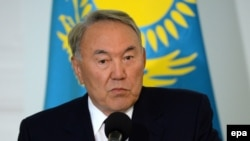 Kazakh President Nursultan Nazarbaev speaks at a press conference after a meeting at the Presidential Palace in Warsaw on August 22.