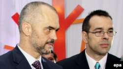 Albanian Prime Minister Edi Rama (left) and his brother, Olsi Rama, whom some blamed for the drone stunt that set off the football melee. (file photo)