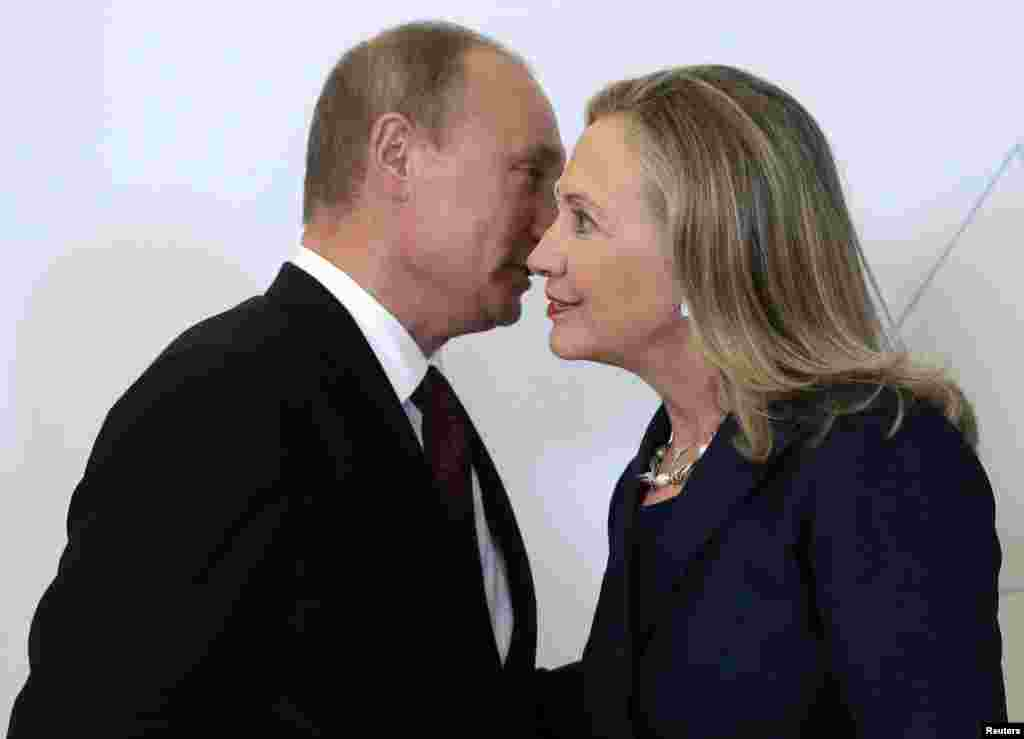 Russian President Vladimir Putin (left) welcomes U.S. Secretary of State Hillary Clinton upon her arrival at the Asia-Pacific Economic Cooperation (APEC) summit in Vladivostok, Russia, on September 8, 2012.
