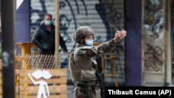 The knife attack took place near the former offices of satirical newspaper Charlie Hebdo on September 25.