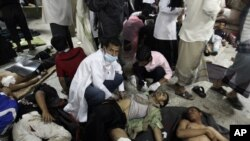 Wounded antigovernment protesters receive medical help at a field hospital during clashes with security forces in Sanaa on September 18.