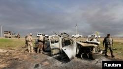 عربة مسلحين دمرتها قوات عراقية في منطقة العلم، 10 آذار 2015
