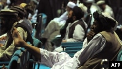 Delegates to the recent so-called Peace Jirga listen to speeches in the main tent on June 4.