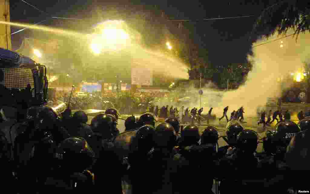 Georgian police use water cannons and tear gas during clashes with protesters in Tbilisi on May 26, 2011. Riot police dispersed several hundred opposition protesters demanding the resignation of President Mikheil Saakashvili.