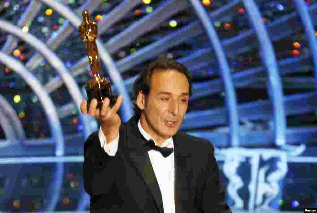 Alexandre Desplat, winner for Best Original Score for The Grand Budapest Hotel.