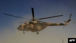 An Afghan helicopter during an offensive against Taliban insurgents in Kunduz in September