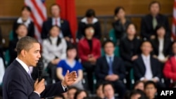 U.S. President Barack Obama addresses a town-hall-style meeting at the Museum of Science and Technology in Shanghai on November 16.