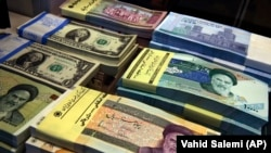 Iranian and U.S. banknotes are on display at a currency exchange shop in downtown Tehran, FILE PHOTO