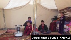 Ирак территориясында көшуге мәжбүр болған ирактықтар (Көрнекі сурет).