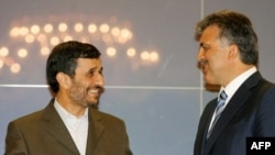 Iranian President Mahmud Ahmadinejad (left) talks with his Turkish counterpart, Abdullah Gul, in Istanbul.