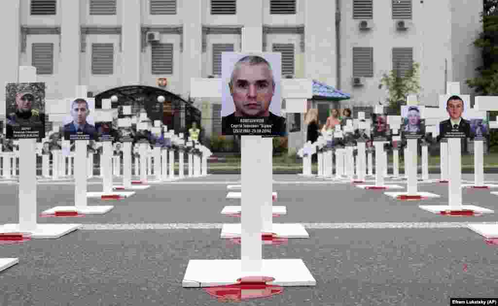 Hundreds of crosses are placed in front of the Russian Embassy in Kyiv on August 29 to symbolize the Ukrainian soldiers killed in the ongoing war in the country's east and to mark the fourth anniversary of the bloody Ilovaisk battle. (AP/Efrem Lukatsky)