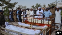 Relatives and residents offer funeral prayers for suicide blast victims in Quetta, Balochistan on August 8.