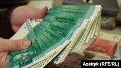 Кыргызстандын улуттук валютасы.