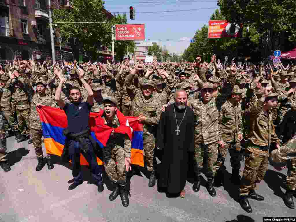 A huge crowd led by soldiers, makes its way towards central Yerevan.