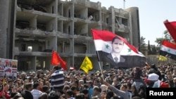 Тазоҳуроти ҷонибдорони Башор Асад дар Димишқ, 18-уми марти соли 2012.