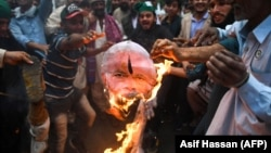 Pakistani Peoples Party activists burn an effigy of Indian Prime Minister Narendra Modi during a protest on March 1.