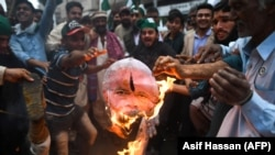 Activists from the Pakistani Peoples Party (PPP) burn an effigy of Indian Prime Minister Narendra Modi during an anti-Indian protest in Karachi on March 1.