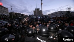 Police push protesters back during a demonstration in support of greater EU integration on Independence Square in Kyiv on November 29.