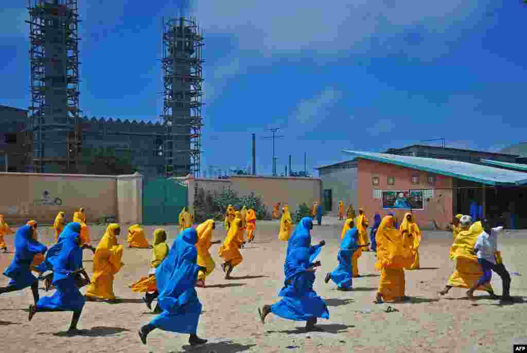 Somali schoolgirls play football during lunch break at an elementary school in Mogadishu. (AFP/Mohamed Abdiwahab)