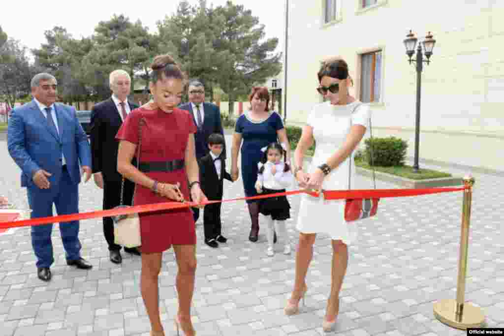 Mehriban Aliyeva, meanwhile, has put in a number of her own public appearances. Here, the Azerbaijani first lady (right) cuts the ribbon at the opening of a Baku kindergarten with her daughter, Leyla, on September 25.