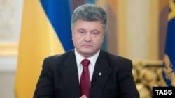 Ukraine -- President Petro Poroshenko (C) during his broadcast address to the nation, June 21, 2014