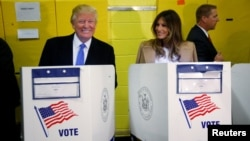 Republican presidential nominee Donald Trump (left) and his wife, Melania, vote in New York City on November 8.