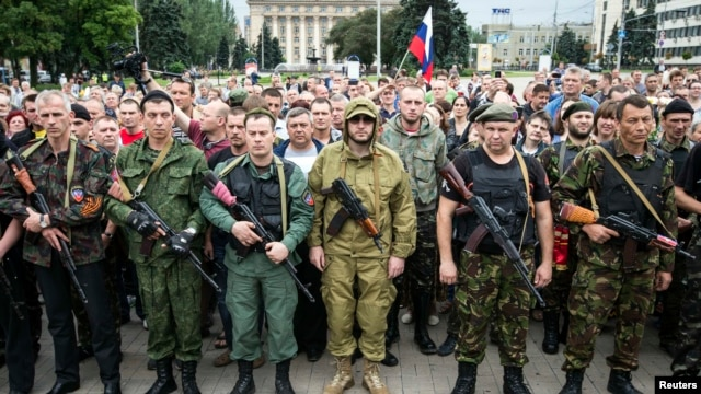 Armed pro-Russian separatists of the self-proclaimed Donetsk People's Republic pledge an oath during a ceremony in Donetsk on June 21.
