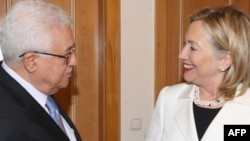 U.S. Secretary of State Hillary Clinton greets Palestinian leader Mahmud Abbas in Sharm El-Sheikh earlier this month.