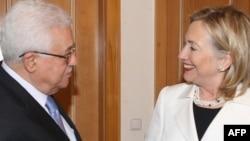 U.S. Secretary of State Hillary Clinton greets Palestinian leader Mahmud Abbas in Sharm El-Sheikh earlier this month.